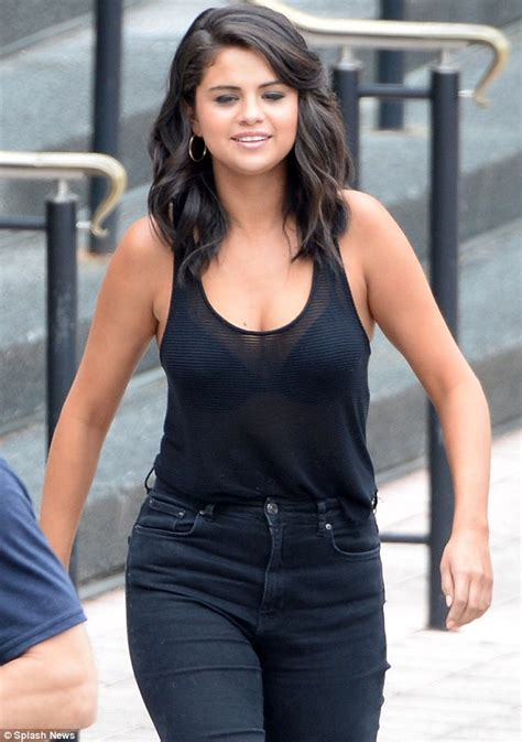 Selena Gomez shows ample cleavage and black bra in New ...