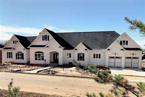 plan tw broad  spacious craftsman home plan  fully loaded walkout basement