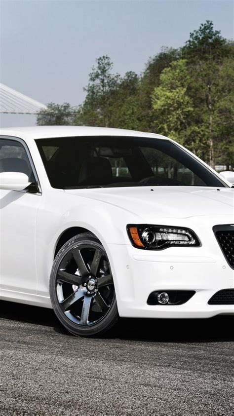 cars vehicles white chrysler  front angle view
