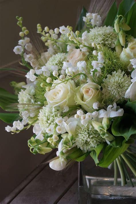 beautiful rustic green  white flower arrangements