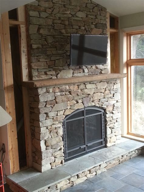 fireplace surround  natural veneer stone   cut