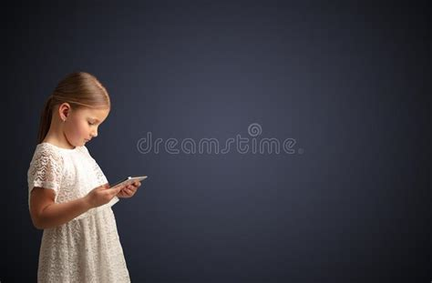 Find the large collection of 12000+ cute background images on pngtree. Cute Little Girl Using Tablet With Dark Background Stock ...