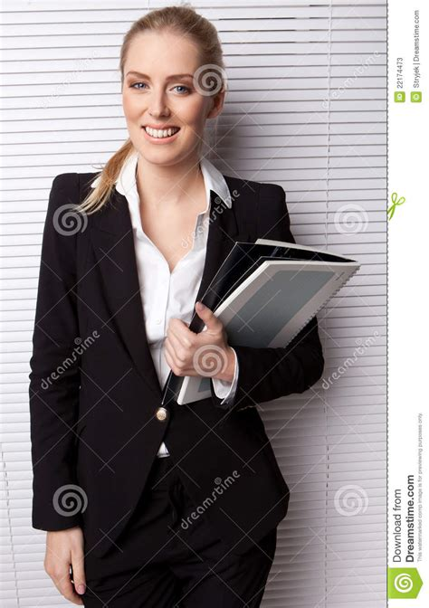 smiling business secretary holding file stock