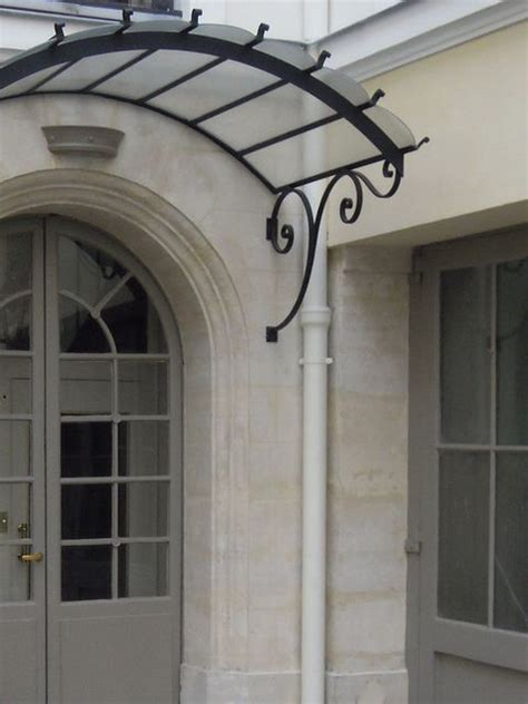 Glass Awning Residential - front door overhang brackets arched wrought iron door