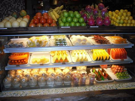 cuisine sold fresh fruit sold in food court of mall photo