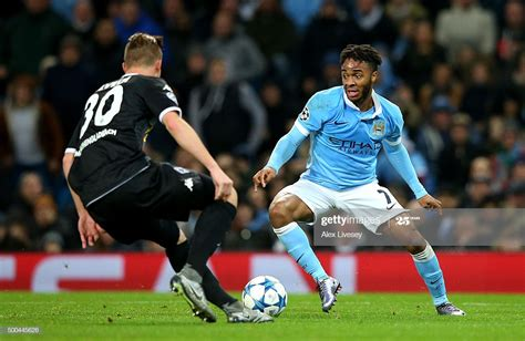 Raheem Sterling of Manchester City takes on Nico Elvedi of ...