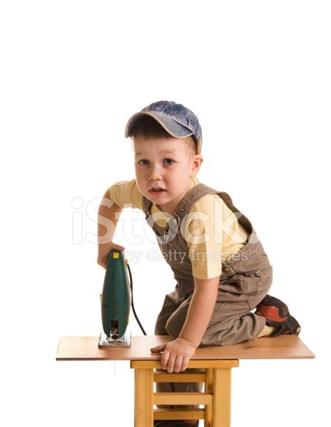 small electric saw carpenter with electrical fretsaw stock photos