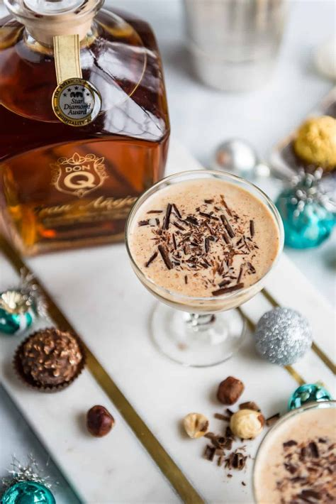 This blend of milk, eggs, and sugar, is a rich and indulgent holiday treat — arguably even better with the addition of bourbon, rum, brandy, or really, any alcohol. Holiday Hazelnut Rum Cocktail   Chocolate cocktails, Rum cocktail, Hazelnut cocktail