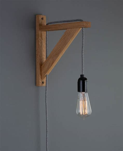 hebden rustic bedroom wall light oak with fabric cable