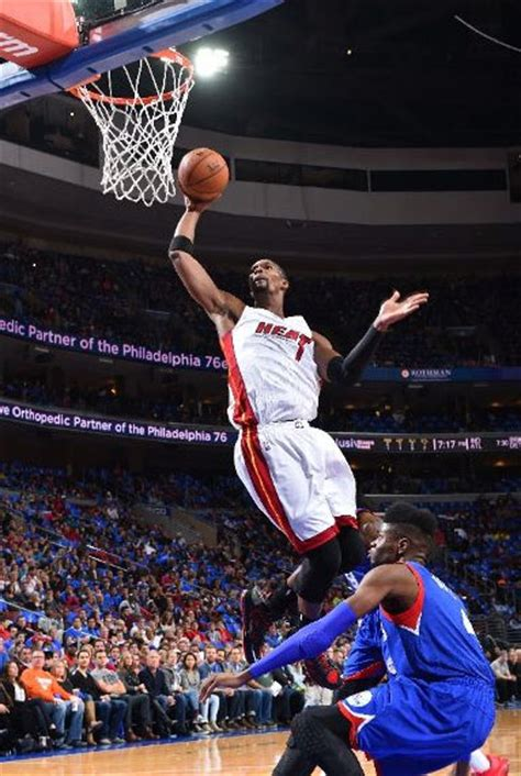 chris bosh dominates ers   points  rebounds