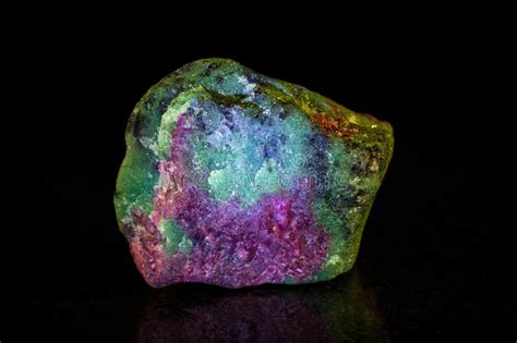 ruby with zoisite in front of black royalty free
