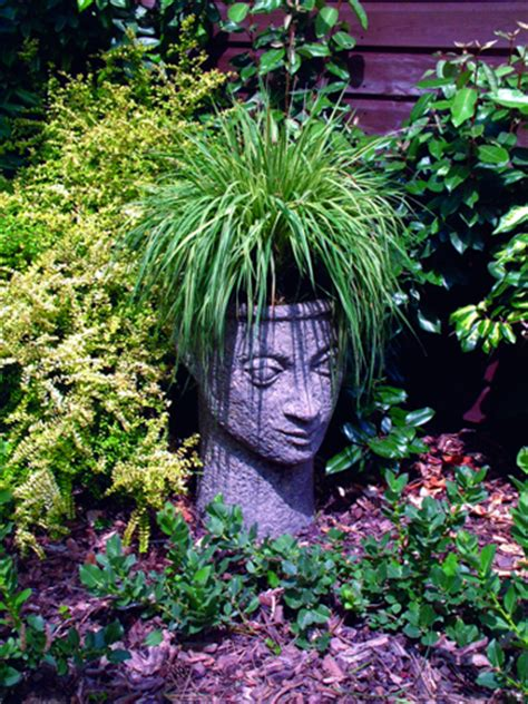 watchful head planter stone statue