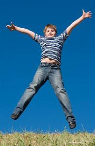 A little boy jumps with sky at background • Plumas County ...