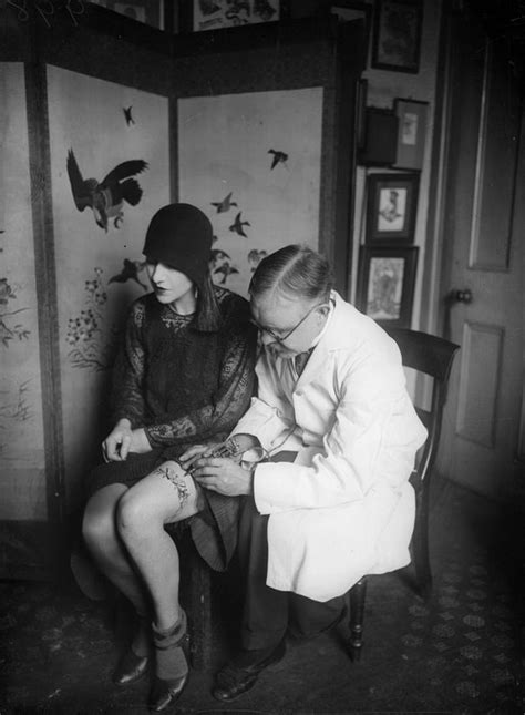 16 Vintage Photographs of Women Showing Their Tattoos From