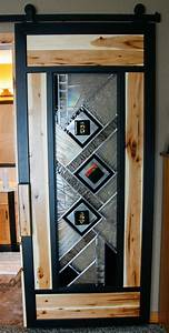 sliding barn door with stained glass and hickory insets With barn door with stained glass