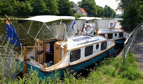 pedaling afloat  phil thiels tiny houseboats