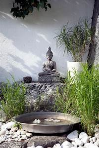 Buddha statue in the garden of natural stone Interior