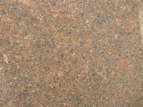 Coffee brown granite is available in both tiles and slabs and recommended for all. Coffee Brown > Natural Stone Kitchen and Bath LLC