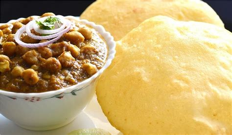 Crispy yet soft bhatura bread is typically paired with spicy chole and served as breakfast and. Top 5 Famous Mouth Watering Foods of Delhi