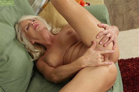 Sexy Mature Blonde Iris Is Lying Naked And Masturbating