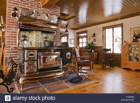 Old Legare's Rural Antique Wood Stove In The Living Room A Canadiana Stock Photo Antique Bathroom Lighting Restoring Furniture Four Poster Beds Rocking Chair Large Mirrors Black Tulip Antiques Columbus Ohio Guns For Sale