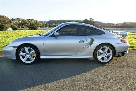 Used 2003 porsche 911 turbo with rwd, fog lights, leather seats, ambient lighting, 18 inch wheels, wind deflector, alloy wheels, bose sound system, seat memory, and side airbags. Used 2003 Porsche Turbo X50 For Sale ($69,900) | Cars Dawydiak Stock #81203