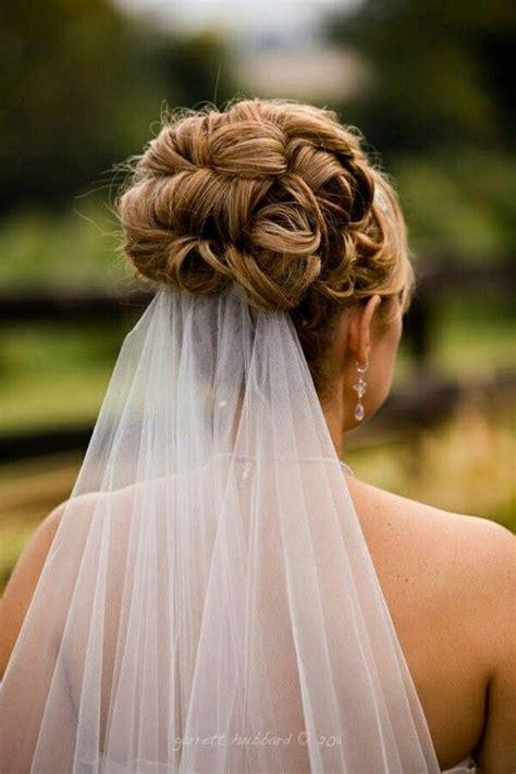 wedding updo with veil underneath wedding hair wedding