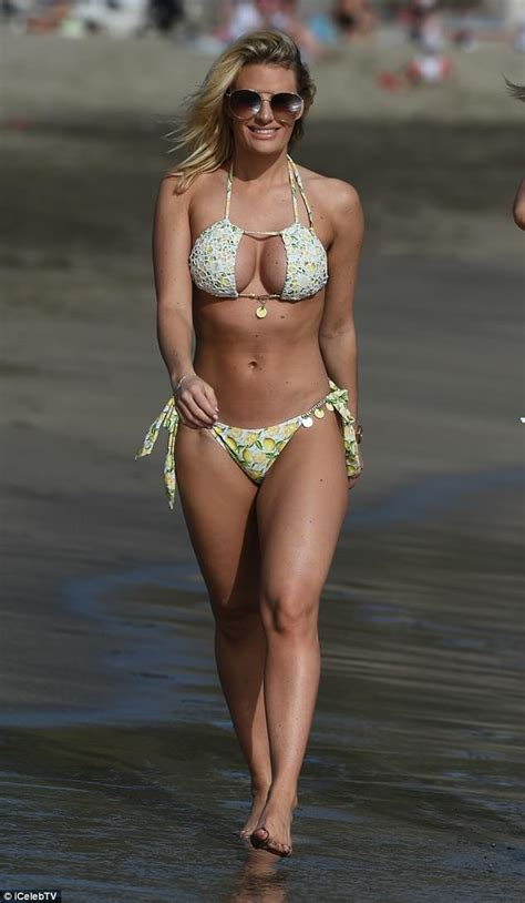 Danielle Armstrong parades her toned bikini-body in Spain ...