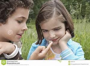 Siblings Watching Caterpillar Outdoors Stock Image - Image ...