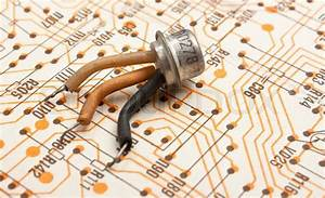 Old Electronic Components Lie On The Wiring Diagram