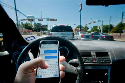texas governor signs texting  driving ban  law