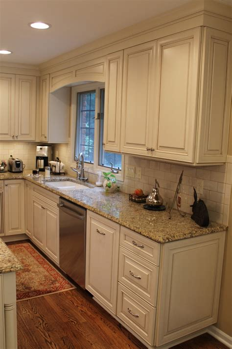 white or cream kitchen cabinets new venetian gold granite kitchen traditional with granite