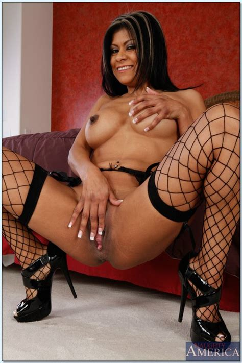 Exotic Looking Sexy Woman In Fishnet Stockings Sho