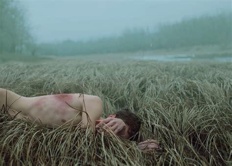 left  dead naked   field  burning times