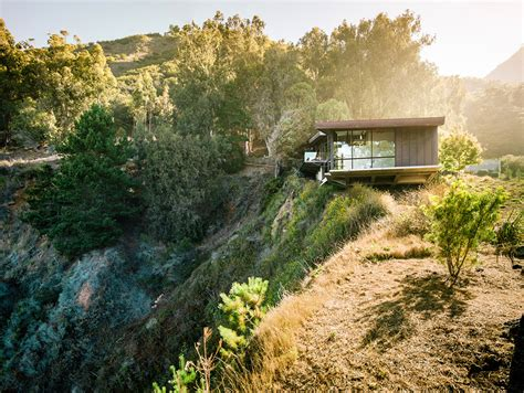 exquisitely shaped by a dramatic landscape fall house in