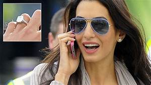 Amal Alamuddin Flashes Her Giant Engagement Ring as She ...