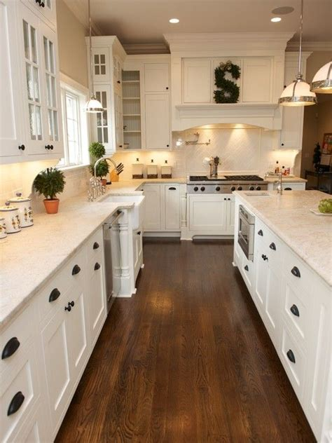 kitchens with hardwood floors and white cabinets white kitchen shaker cabinets hardwood floor black 770 | d1876a9cacb5bd415fab78f268a1de46