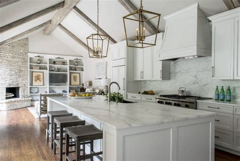 Remodeled White Kitchen With Vaulted Ceiling Beams-home