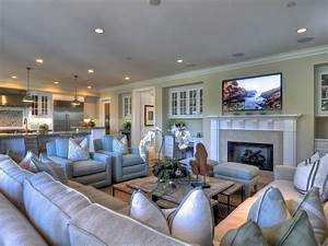 Coastal decor is found in the details in this spacious for Sectional couch living room layout