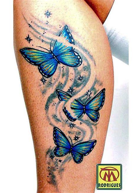 blue  yellow butterfly tattoo  side leg