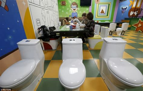 moscows  toilet themed cafe  diners sit