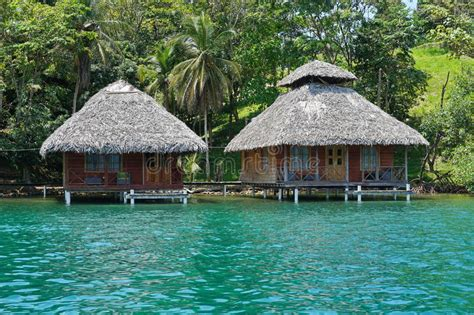 Tropical Wooden Bungalows Over The Water Stock Photo