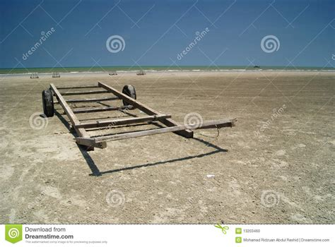 wooden boat trailer  beach stock photo image  water
