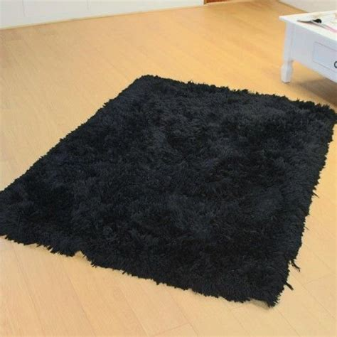 Black Fuzzy Rug by Comments By Adrivo