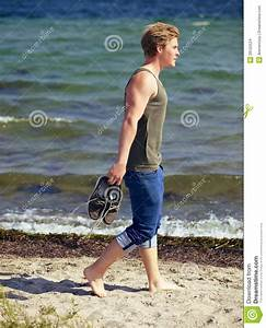 Handsome Man Walking Alone On The Beach Stock Images ...