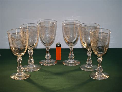 A Set Of 6 Antique Crystal Cut And Etched Wine Glasses