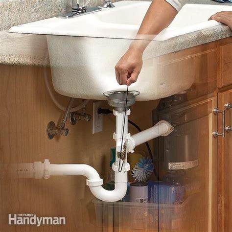 unclog  kitchen sink  family handyman  family  unclog  drain