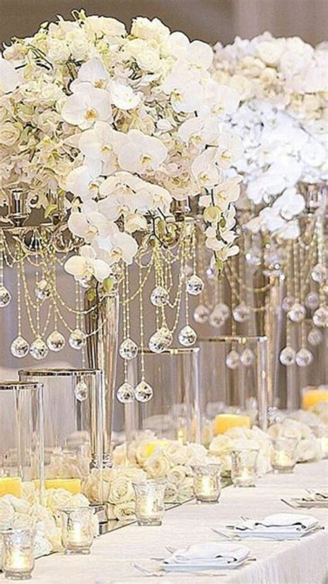 Orchids In Tall Centerpieces Over The Top Tall Wedding