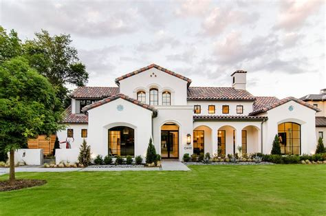 exterior stucco colors mediterranean with arched doorway traditional landscaping stones and pavers