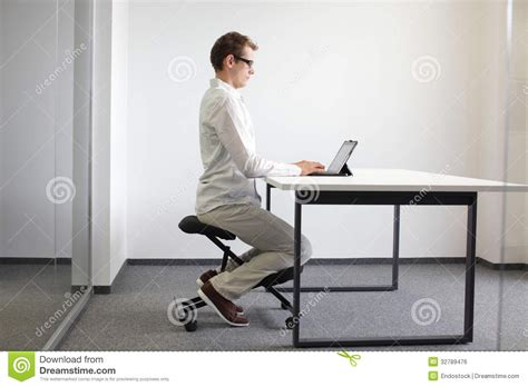 correct sitting position on kneeling chair royalty free